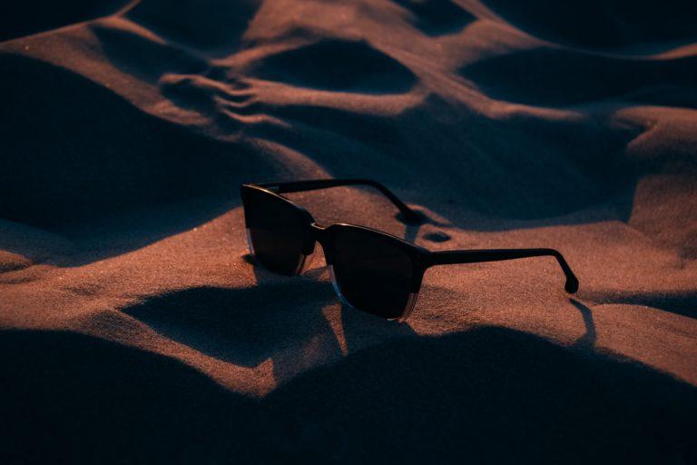 Polarized Sun Glasses On Sand.