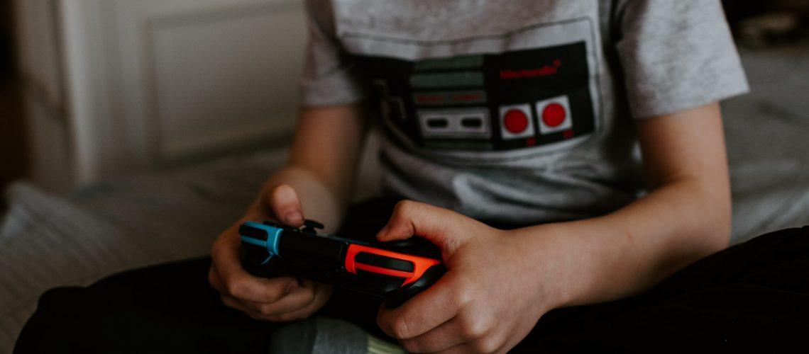 Child Playing A Nintendo Switch.